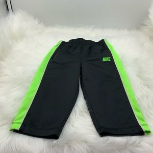 Nike. Black and neon green pants. Size for 18 mont
